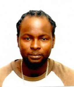 He is Gordon Andrew Roberts, alias 'Pinter', 33 years of # 10 Harmony Hall, Christ Church.  He is about 6 feet in height, slim build, he is of brown complexion, wears a black low hair style.  He has brown eyes, large forehead and a goatee beard.