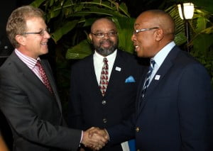 Robert Jackson (centre), General Manager of Sol Petroleum Jamaica Ltd warmly introducing Matthew Pragnell, CEO of the CGM Gallagher Group (left) to Andrew Rollins, CFO of SOL CARIBBEAN LTD.