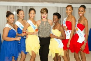 The very talented Tessanne Chin (Centre) is flanked by Sol hostesses at the recent launch of Sol Petroleum Jamaica Ltd.