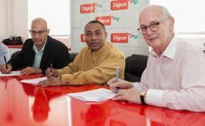 (L to R) The Honourable Dr. Edmond Mansoor, Minister of State in the Office of the Prime Minister of Antigua and Barbuda, Papua New Guinea's Minister for Mining, the Honourable Byron Chan, and PJ Mara, Digicel Group Board Director sign the MOU in Antigua