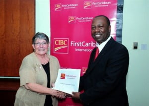Edna Moore, Secretary of Barbados Poppy League, tells Radcliffe Nurse, Head of Corporate, CIBC FirstCaribbean how funds raised from the Poppy Appeal are used to help Legionnaires in need. The Poppy League received a donation from the bank recently.