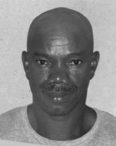 "He is Terry Cassius Seale, alias 'Short Man', 50 years of Grooves, St. George.  He is about 5'6"" in height, medium build, has broad shoulders and is of dark complexion.  He has brown eyes, black and grey hair, with a receding hair line."