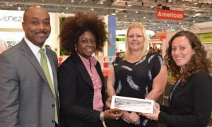 Leesa Parris-Rudder and Deryck Clarke present Kate Leigh (right) and Becci Oaten of Virgin Atlantic with a peace offering LIAT memento during World Travel Market in London.
