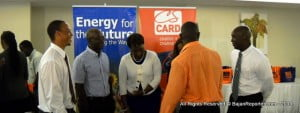 L to R - Kirk King ^ Roger Bryan of SOL Petroleum chat and compare notes with Alison Ellis & Kaylene Henry (partially obscured) of Cave Shepherd's marketing dept. as Sherlock Small of RED Advertising (backing camera in salmon shirt) and Ezra Prescod - Country Mgr of SOL Barbados listen in...