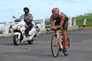 Winner of the first ever MaccaX Nevis International Triathlon Chris McCormack held in Nevis on November 16, 2013 cycling round the island