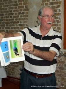 Editor Dr Karl Watson proudly displaying the almost-National Geographic quality bird photos in this edition.