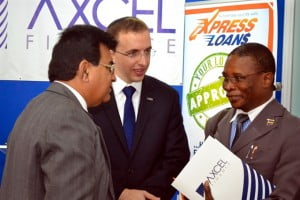 PRESIDENT of the Chamber of Commerce Lalu Vaswani (left), CEO of Axcel Finance, Sam Rosenberg and Minister of Housing Denis Kellman in conversation after the launch.
