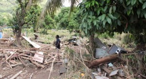 A resident of Buccament Bay surveys the damage there on Thursday. (IWN photo)