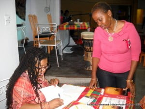 Annette I. Smith autographing for a new fan of her historical fiction