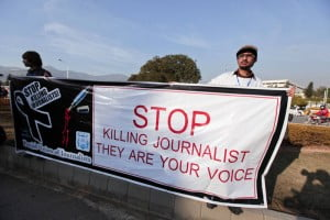 Journalists hold a banner on Jan. 28, 2013 while taking part in a demonstration in front of the Parliament building in Islamabad. REUTERS/Faisal Mahmood