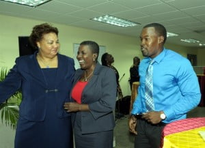 A surprised Lynda Goodridge, Director Regional Operations (Barbados), (centre) is met at a celebration in honour of her 40th anniversary at CIBC FirstCaribbean by her son Gregory Simmons and Ella Hoyos, Managing Director, Human Resources.
