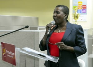 """Lynda Goodridge, Director Regional Operations (Barbados) gives an impromptu rendition of the hymn, """"Amazing Grace"""" before expressing her appreciation to CIBC FirstCaribbean for the opportunities it has given her throughout her 40-year career there."""