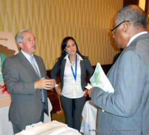Cancer is a chronic condition and there is a pressing need to improve cancer care in the Caribbean. Here, John Boyce, Min. of Health (B'dos) pauses and confers with ASCO booth operators at Needham's Ballroom of Hilton Barbados.
