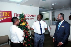 Divisional Secretary of the Salvation Army, Captain Robert Pyle (centre) shares plans for the army's programmes for the less fortunate with Michelle Whitelaw, CIBC FirstCaribbean's Director of Retail Banking, Barbados; and Richard Kennedy, Warrens Banking Centre Branch Manager.