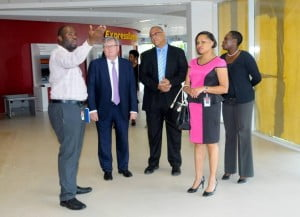 Branch Manager, Richard Kennedy, points out some of the features of the new branch to - from left to right – Rik Parkhill, Chief Executive Officer; Mark St.Hill, Managing Director of Retail and Business Banking; Donna Wellington, Managing Director, Barbados Business, and Michelle Whitelaw, Director of Retail Banking, Barbados.