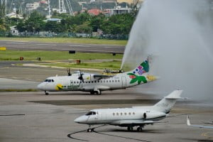 The WINAIR inaugural Santo Domingo – SXM flight being welcomed with the traditional water cannon salute at SXM Airport Monday afternoon. The ATR-42 aircraft is reportedly leased from Air Antilles. (Photo courtesy Robbie Cijntje)