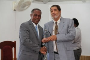 Premier of Nevis Hon. Vance Amory (left) receiving a plaque from Deputy Governor General His Honour Eustace John from the Nevis Island Assembly as one of the longest serving parliamentarian at a special sitting of the Assembly on December 10, 2013 at the at its Chambers in Hamilton House