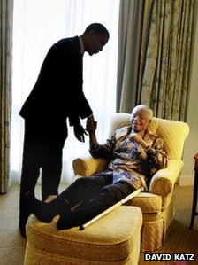"""{IMAGE VIA - bbc.co.uk per 2005} """"We will not likely see the likes of Nelson Mandela again,"""" the President said. """"So it falls to us as best we can to forward the example that he set: to make decisions guided not by hate, but by love; to never discount the difference that one person can make; to strive for a future that is worthy of his sacrifice."""""""