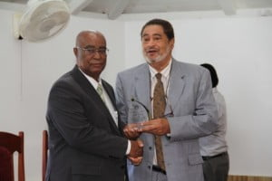 Leader of the Opposition Hon. Joseph Parry (left) receiving a plaque from Deputy Governor General His Honour Eustace John from the Nevis Island Assembly as one of the longest serving parliamentarian at a special sitting of the Assembly on December 10, 2013 at the at its Chambers in Hamilton House