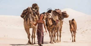 {IMAGE VIA - collider.com} Based on a true story; A young woman goes on a 1,700 mile trek across the deserts of West Australia with her four camels and faithful dog.