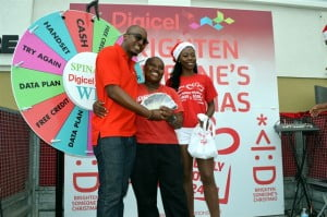 Car wash operator, Farrah (centre), was the grand finale of $5,000 in cash, which she won on Christmas Eve at the new Digicel Head office in Warrens, St. Michael.