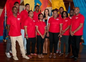 IDB's Chief of Operations, Christel Saab posing with students from Trinidad and Tobago at the launch of the Caribbean Secondary School Drama Festival.