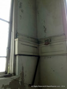 The deteriorating walls along the stairwell in Hayes Court. Photo courtesy the Hayes Court Restoration Committee.