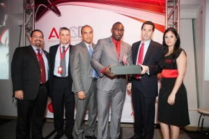 Enterprise Account Manager at Digicel Business, Duwayne Watson (2nd right), collects the Avaya Partner of the Year award from Avaya's Systems Sales Engineer, Nikolas Schnoor (right) at the Avaya Partner Connection Day Awards held in Puerto Rico on January 16. Looking on are (from L-R), Marketing Manager for the Caribbean and Central America, Ramon Lopez; Managing Director, Jose Fernandez and Channel Sales Leader, Santiago Aguirre