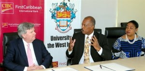 Pro-Vice-Chancellor and Principal of the University of the West Indies, Cave Hill, Professor Sir Hilary Beckles discusses the significance of UWI's long-standing partnership with CIBC FirstCaribbean with its CEO Rik Parkhill (left) and Business Development Officer, UWI, Cave Hill, Sonia Johnson. The partnership has seen over US $1.425 million contributed by the bank to regional development through education, research, and entrepreneurship.