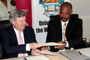 Chief Executive Officer of CIBC FirstCaribbean and Chairman of the ComTrust Foundation Rik Parkhill (left), and Pro-Vice-Chancellor and Principal of the University of the West Indies, Cave Hill, Professor Sir Hilary Beckles recently signed an MOU to continue the long-standing partnership between the two entities in support of regional development.