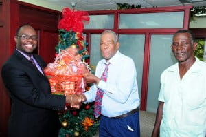 Richard Kennedy, Warrens Banking Centre Branch Manager (left) presents the Angel Tree programme's Thomas Watts and Pastor Peter Lambert with one of the hampers to which the bank contributed at the bank's Rendezvous offices recently.