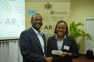 Bevil Wooding, Internet Strategist, receives a token of appreciation at the first ICT-Led Innovation Workshop, Gros Islet, St Lucia on February 10th-11th, 2014.