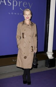 Looking very like a Queen, and far from RED ... Dame Helen Mirren wearing Burberry to the EE British Academy Film Awards Nominees Party in London, 15 February 2014