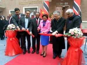 Mrs. Kamla Persad-Bissessar, Prime Minister of the Republic of Trinidad and Tobago (centre) is joined by His Excellency Chandradath Singh (3rd left); Zhong Shan - Vice Minister of Commerce, China (2nd right); Senator Vasant Bharath, Minister of Trade, Industry and Investment (2nd left); the Honourable Winston Dookeran, Minister of Foreign Affairs (right); and Senator Kevin Ramnarine, Minister of Energy and Energy Affairs (left) at the Official Ribbon Cutting Ceremony