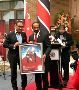 Senator the Honourable Vasant Bharath (LEFT) makes a presentation to His Excellency Chandradath Singh, Ambassador to Beijing China (RIGHT).