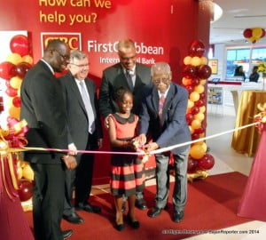 Rik Parkhill, Chief Executive Officer; and Donna Wellington, Managing Director, Barbados; gave remarks at the 13,700 Sq. Ft. Centre. Inset is oldest customer Ivan Burrowes and one of the youngest customers Shania Graham helping in the Official ribbon-cutting ceremony...