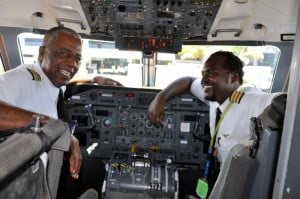 Captain Keith Robertson (left) with his son First Officer Kori Robertson in the flight deck of a LIAT aircraft