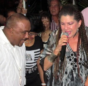 Veteran Calypso Queen Denyse Plummer engages a patron at the Canadian Women's Club All Inclusive