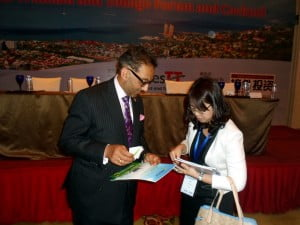 Minister Bharath (right) interacts with an interested investor at the Business Forum
