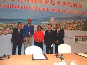 Kamla Persad-Bissessar, Prime Minister (centre), Senator Bharath (right), Mr. Cen Furong, Chairman of CCPIT Shanghai Sub-Council (2nd left) and two attendees at the Business Forum (left).