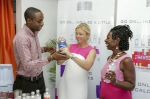 Alexis Garrett (centre), BHL's category manager with responsibility for CLEAR, makes a CLEAR-inspired cocktail as mixologist David Barker and Annette Sandiford, treasurer and fundraising chair of the Diabetes Association of Barbados, look on.
