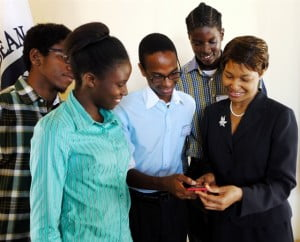 Secretary General of the Caribbean Telecommunications Union, Bernadette Lewis (right) shares a light moment with Saint Vincent and the Grenadines Community College students, from left, Cenus Hinds, Zanis Sandy, Rotasha Medford and Shaquille Neil at the CARCIP Saint Vincent and the Grenadines Innovation Workshop, Buccament Bay Resort, Saint Vincent, February 26th, 2014. The students created a mobile Open Government app, which was presented at the workshop by Ayodele Pompey, CEO, Digital Spark Global.