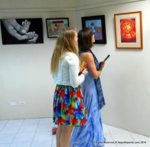 Patrons captivated by the works and deciding which pictures to take home...