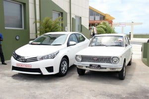 Old versus new – the 1968 model of the Toyota Corolla next to the sleek 2014 model on display next to the Walcott Warner Theatre on Cave Hill during the press launch.