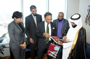 Trade Minister, Vasant Bharath (left) presents a copy of the Trinidad and Tobago Golden Jubilee Edition to His Excellency Dr. Fahad Al Dawood (right). Looking on are Mrs. Racquel Moses, President invesTT; Mr. Umar Kkan, TSCC Chair and Coordinator of the Delegation; and Mr. Shazaad Razul Mohammed