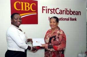 Managing Director of the Arnott Cato Foundation, Margaret Hope (right) receives funds to go towards the improved delivery of health care across the region from Barbados Retail Banking Director, CIBC FirstCaribbean International Bank, Michelle Whitelaw.