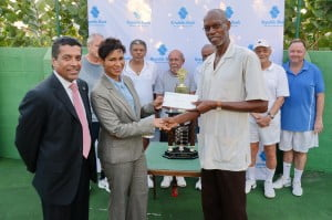 Mrs. Sharon Zephirin, Senior Manager, Retail Services and Mr. Ian De Souza, Managing Director & CEO, Republic Bank (Barbados) Limited (left) presenting sponsorship cheque to President of Barbados Tennis Association President, Dr. Forde (right) joined by members of the Summerhayes Tennis Club.
