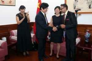 His Excellency Huang Xingyuan, Ambassador of  the People's Republic of China to the Republic of Trinidad and Tobago (2nd left) greets Trade Minister (right) as Ms. Ying Liu Commercial Attaché (centre) and Mrs. Racquel Moses, President invesTT (left) looks on.