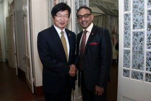 His Excellency Huang Xingyuan, Ambassador of  the People's Republic of China to the Republic of Trinidad and Tobago (left) greets Trade Minister (right) at the dinner hosted by the Embassy