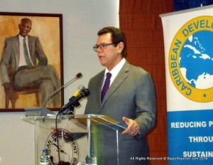 """Dr. Warren Smith, President of the CDB, said of Holder: """"Over time, (he) has become synonymous with many things - the Caribbean Trade Reference Centre (and) the Caribbean Tourism Organization, where he was the founding father and where he honed his craft as the region's premier tourism expert. Most recently, he has been lending his experience by serving as Chairman of LIAT,"""" helping the airline """"chart its way forward through a very turbulent period."""""""
